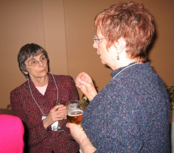 Gwen and Sharon compare notes.
