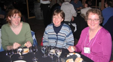Christine, Linda and Marilyn are enjoying the entertainment.